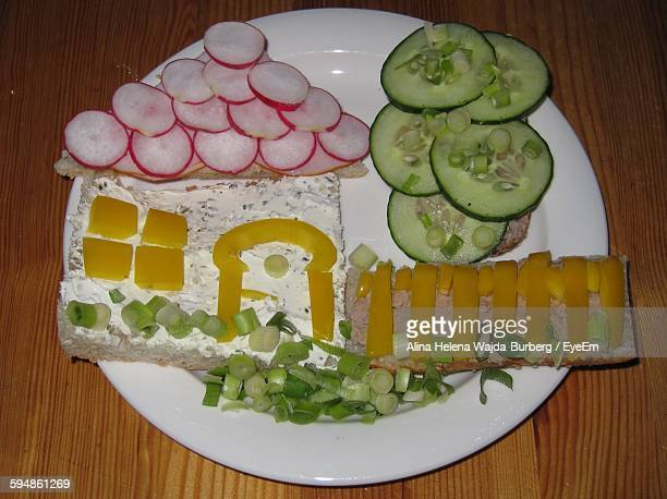 High Angle View Of House Made From Bread And Vegetables