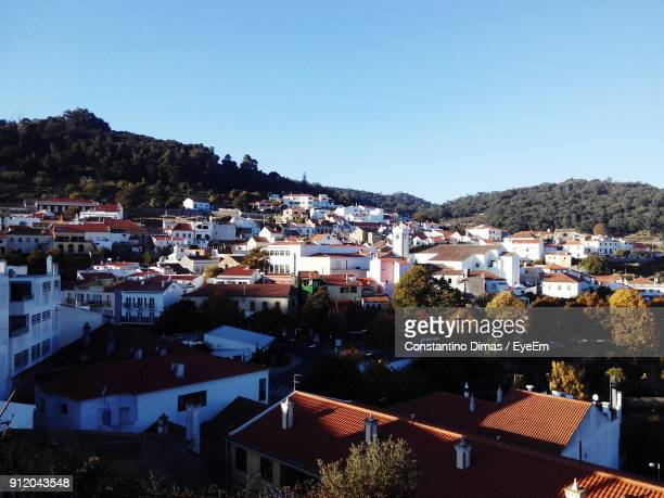 high angle view of houses against clear blue sky - monchique stock pictures, royalty-free photos & images