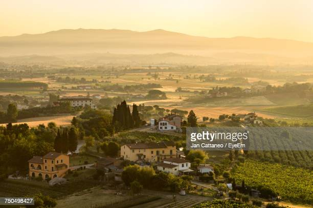 high angle view of houses against clear sky - san miniato stock-fotos und bilder