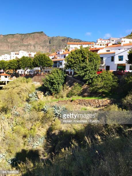 high angle view of houses against clear sky - tejeda canary islands stock pictures, royalty-free photos & images