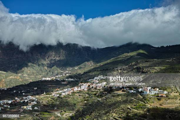 high angle view of houses against sky - tejeda canary islands stock pictures, royalty-free photos & images