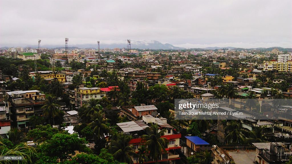 High Angle View Of Houses And Buildings In City : Stock Photo