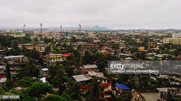 high angle view of houses and buildings in city - guwahati stock photos and pictures