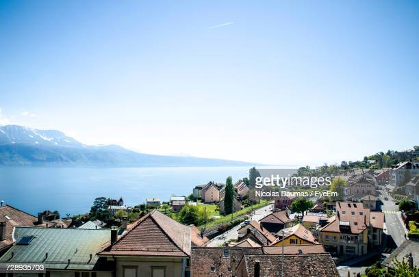 high angle view of houses and mountains against clear blue sky - kanton waadt stock-fotos und bilder