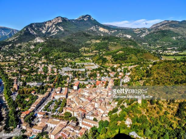 High Angle View Of Houses And Mountains Against Clear Blue Sky