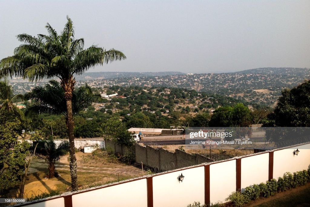 High Angle View Of Houses And Mountains Against Clear Sky : Stock Photo