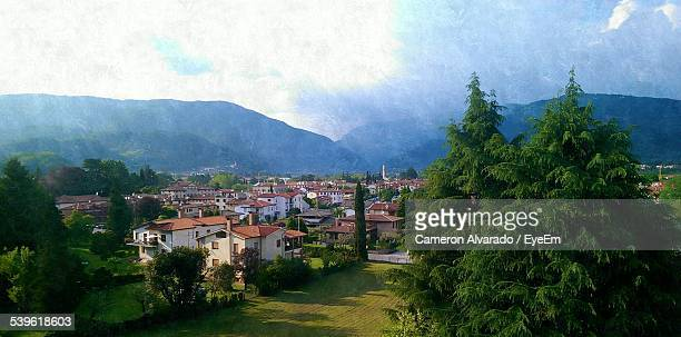 high angle view of houses and mountains against sky - バッサーノデルグラッパ ストックフォトと画像
