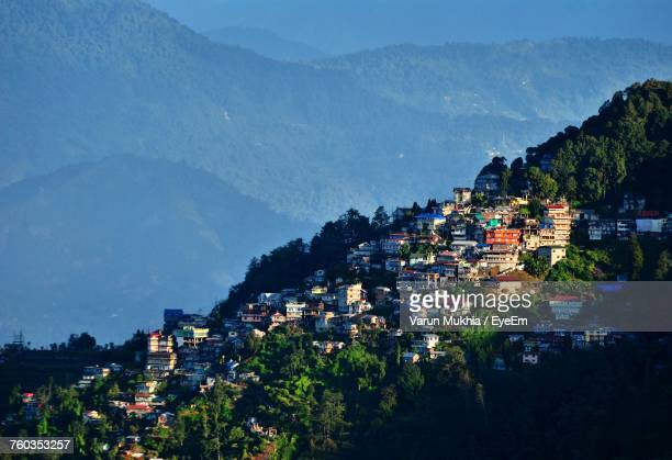 high angle view of houses and mountains against sky - hyderabad indien stock-fotos und bilder