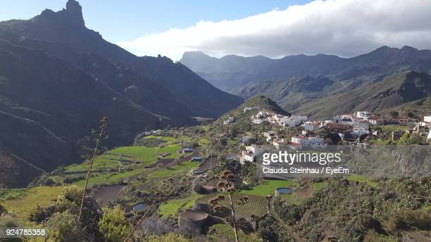 high angle view of houses and mountains against sky - tejeda canary islands stock pictures, royalty-free photos & images