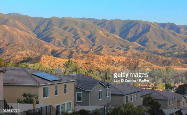 high angle view of houses and mountains against sky - santa clarita stock pictures, royalty-free photos & images