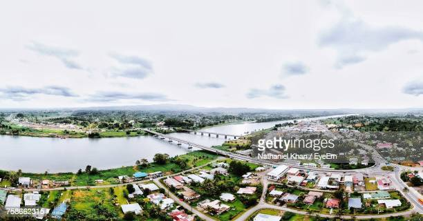 High Angle View Of Houses And River Against Sky
