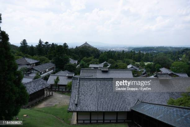 high angle view of houses and trees against sky - 奈良市 ストックフォトと画像