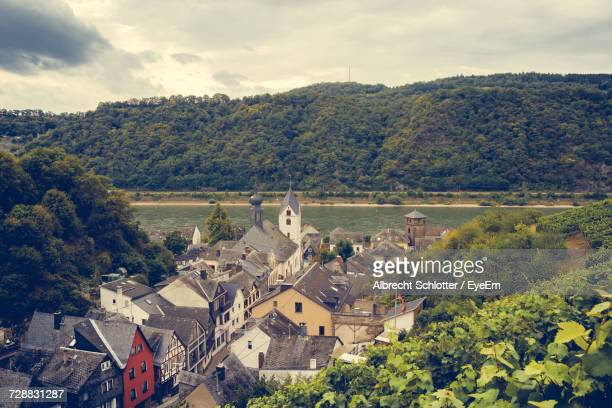 high angle view of houses and trees against sky - albrecht schlotter stock photos and pictures