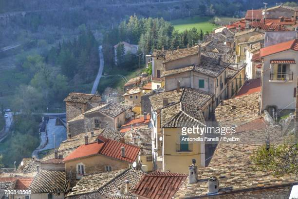 high angle view of houses and trees - antonella stock photos and pictures