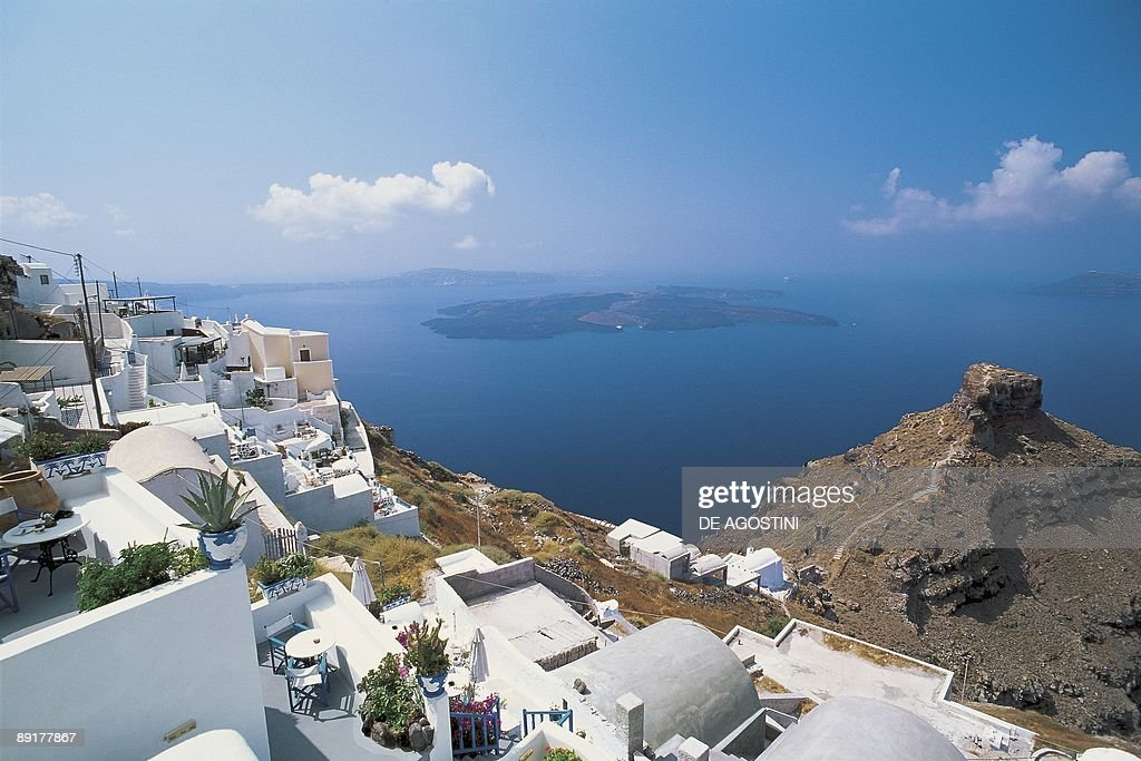 High angle view of houses at the waterfront, Imerovigli, Nea Kameni, Santorini, Cyclades Islands, Southern Aegean, Greece : News Photo