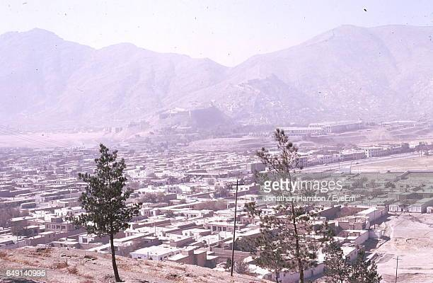 High Angle View Of Houses By Mountains In City
