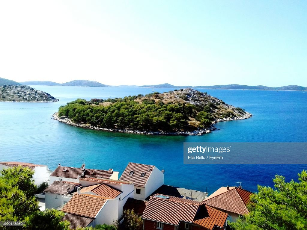 High Angle View Of Houses By Sea Against Clear Sky : Stock Photo
