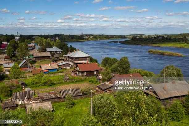 high angle view of houses by sea against sky - zinchenko stock pictures, royalty-free photos & images