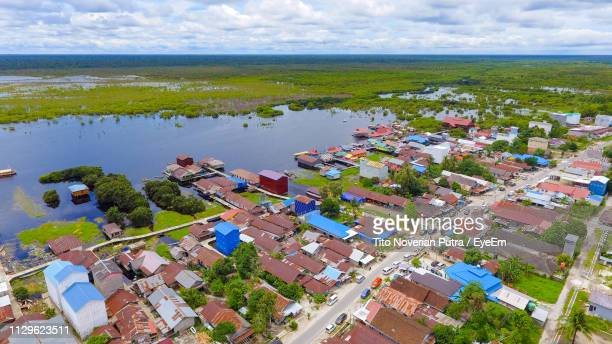 high angle view of houses by sea against sky - central kalimantan stock pictures, royalty-free photos & images