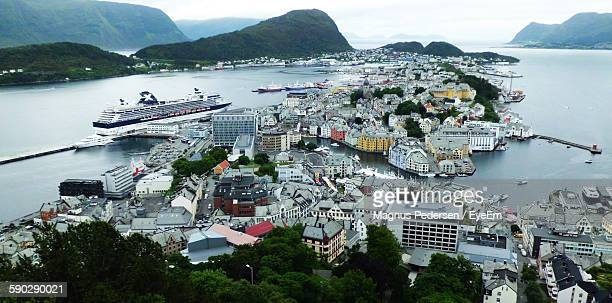 High Angle View Of Houses By Sea At Alesund