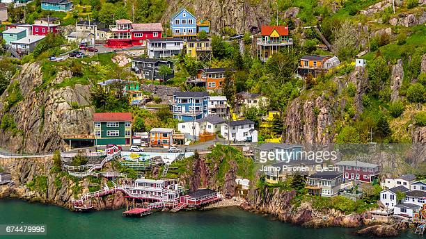 high angle view of houses by sea at st. johns - st. john's newfoundland stock photos and pictures