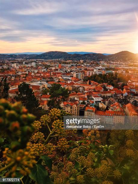 high angle view of houses in town against sky - graz stock photos and pictures