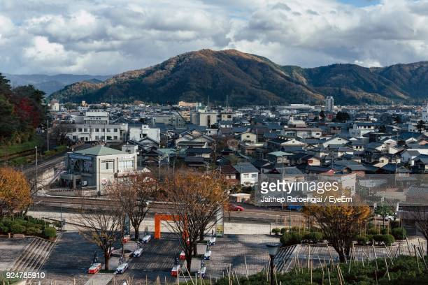 high angle view of houses in town against sky - 福井県 ストックフォトと画像