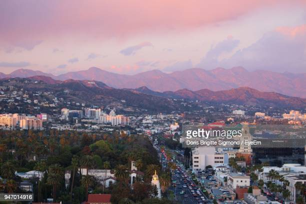high angle view of houses in town against sky - hollywood california stock photos and pictures
