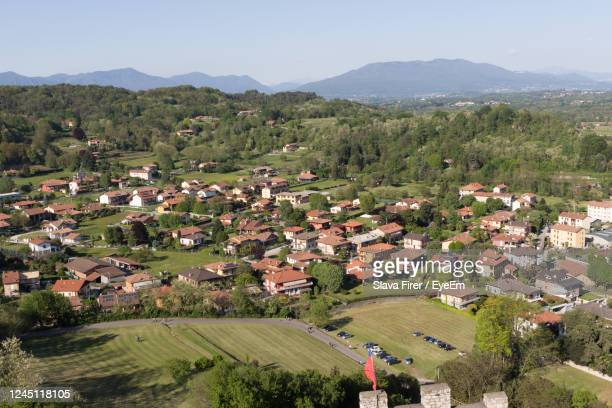 high angle view of houses on field against sky - stresa ストックフォトと画像