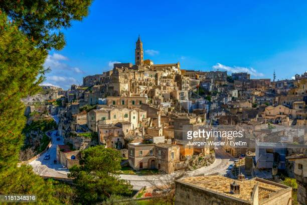 high angle view of houses on mountain against blue sky during sunny day - basilicata region stock pictures, royalty-free photos & images