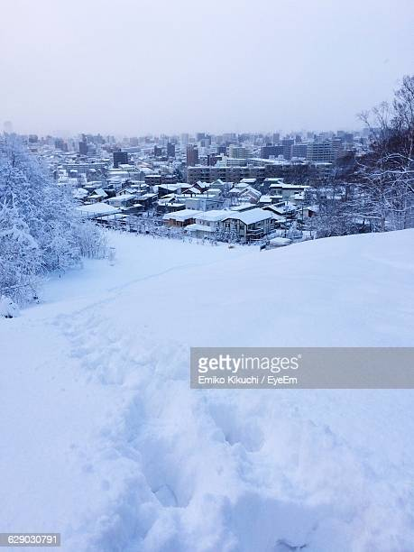 High Angle View Of Houses On Snow Covered Field