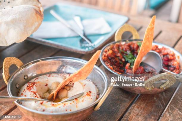 high angle view of hummus and spicy tomato salad on table - dubai stock pictures, royalty-free photos & images