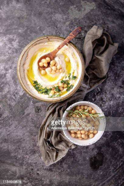 high angle view of hummus in bowl on table - ハマス ストックフォトと画像
