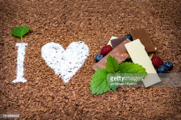High Angle View Of \i Love Chocolate\ Written In Chocolate