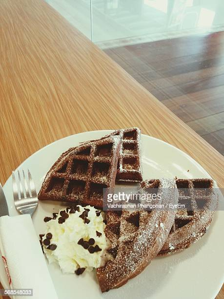 High Angle View Of Ice Cream With Waffles In Plate On Table