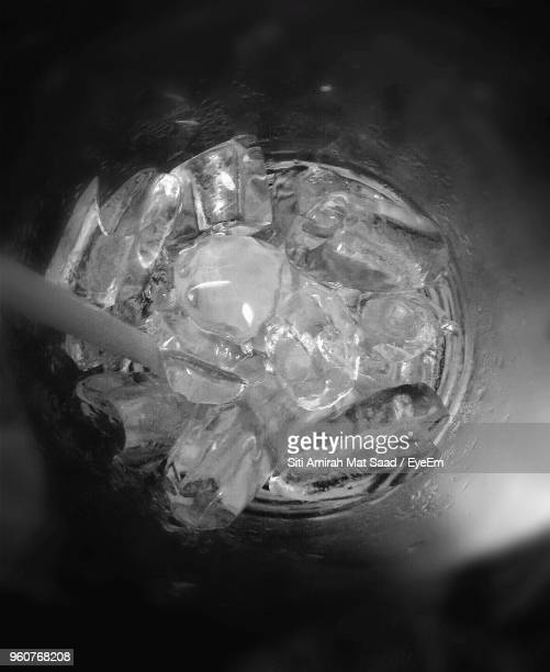 High Angle View Of Ice Cubes In Drinking Glass