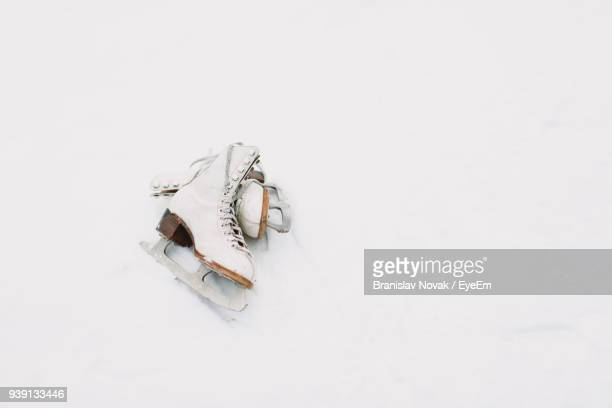 high angle view of ice skates on white background - ice skate stock pictures, royalty-free photos & images