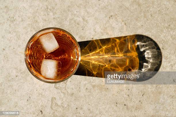 High angle view of ice tea, with two cubes of ice floating in it