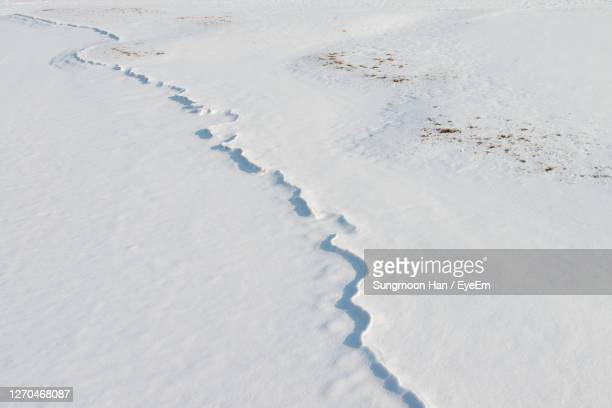 high angle view of ice tracks on snow - gwangju stock pictures, royalty-free photos & images