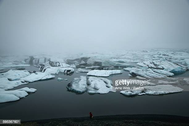 High Angle View Of Icebergs On Lake Against Sky