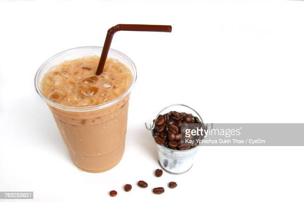 High Angle View Of Iced Coffee Against White Background