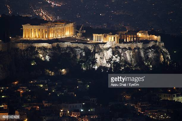 High Angle View Of Illuminated Acropolis And Buildings At Night