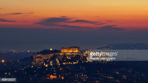 High Angle View Of Illuminated Acropolis Temple Against Sky At Dusk