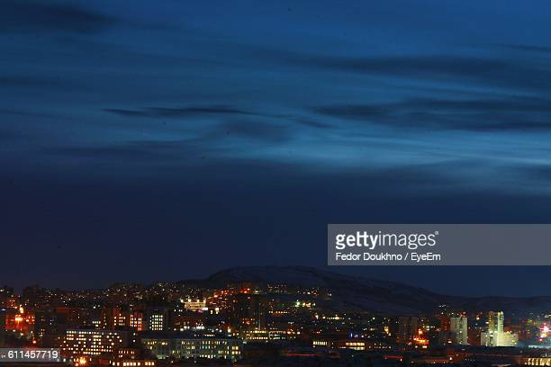 high angle view of illuminated buildings against blue sky at night - fedor stock pictures, royalty-free photos & images