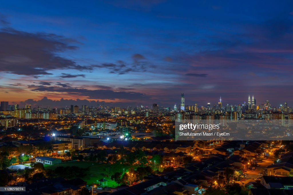 High Angle View Of Illuminated Buildings Against Sky At Night : Stock Photo