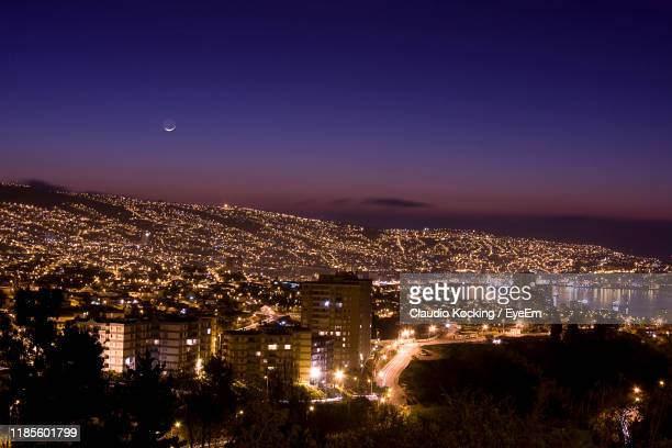 high angle view of illuminated buildings against sky at night - valparaiso chile stock pictures, royalty-free photos & images
