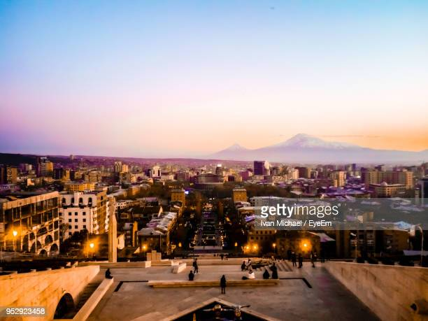 high angle view of illuminated buildings against sky at sunset - yerevan stock pictures, royalty-free photos & images