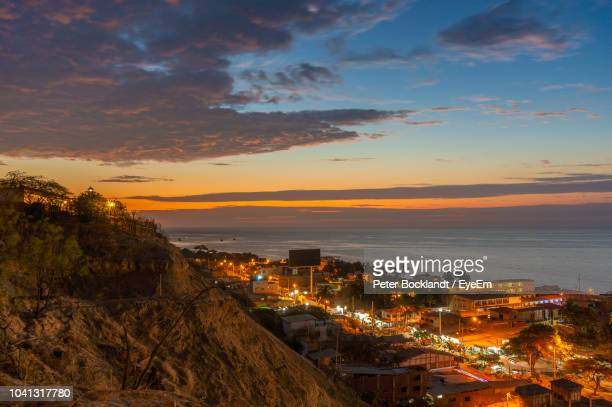high angle view of illuminated buildings against sky during sunset - mancora fotografías e imágenes de stock