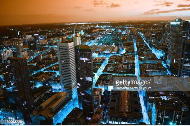high angle view of illuminated buildings against sky during sunset - frankfurt germany stock pictures, royalty-free photos & images