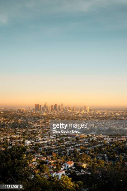 high angle view of illuminated buildings against sky during sunset - hollywood los angeles ストックフォトと画像